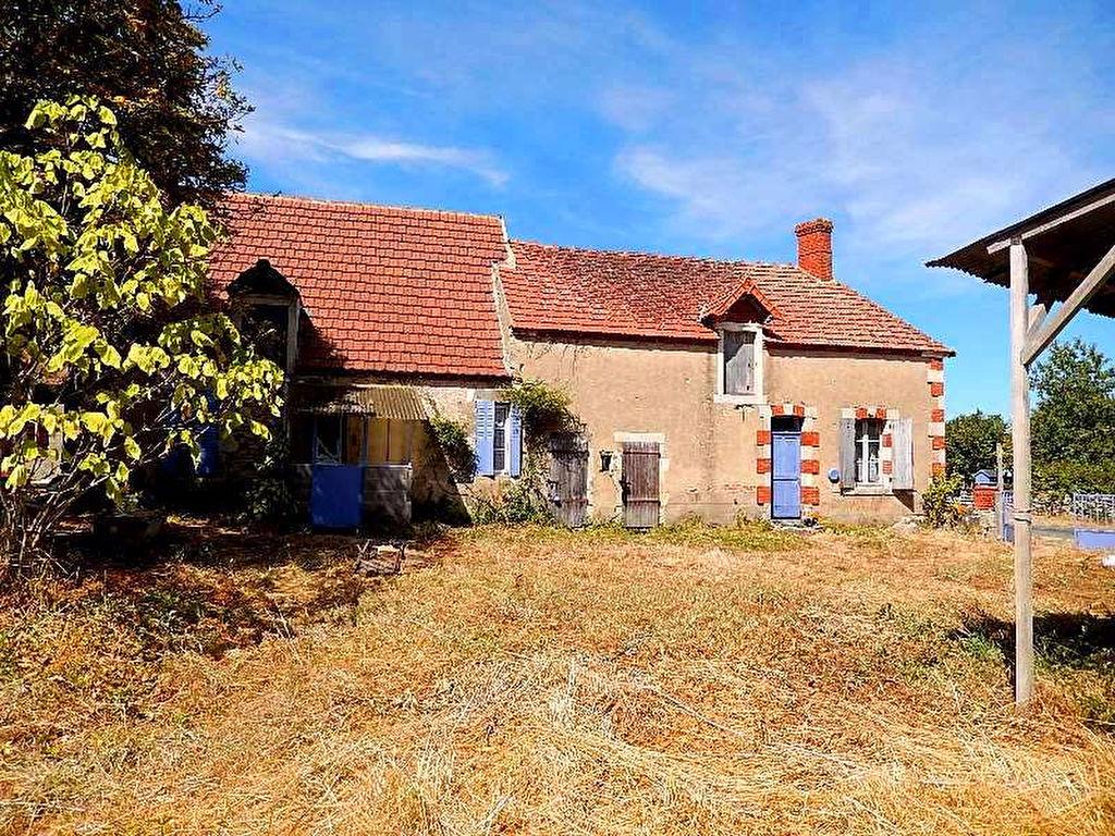Reigny - En bordure d'un petit village se trouvent ces deux maisons sur un terrain de 2700m².