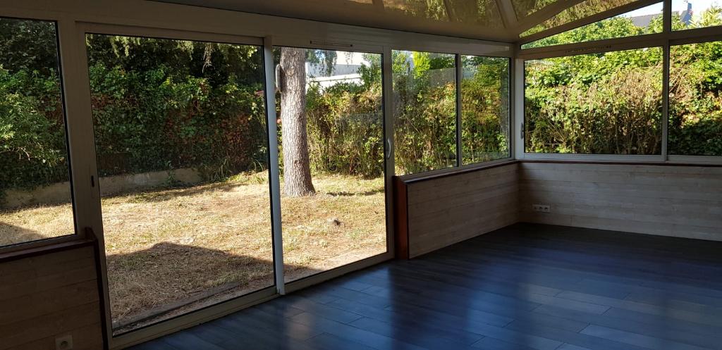 Appartement T3 avec véranda de 25m² et jardin privatif