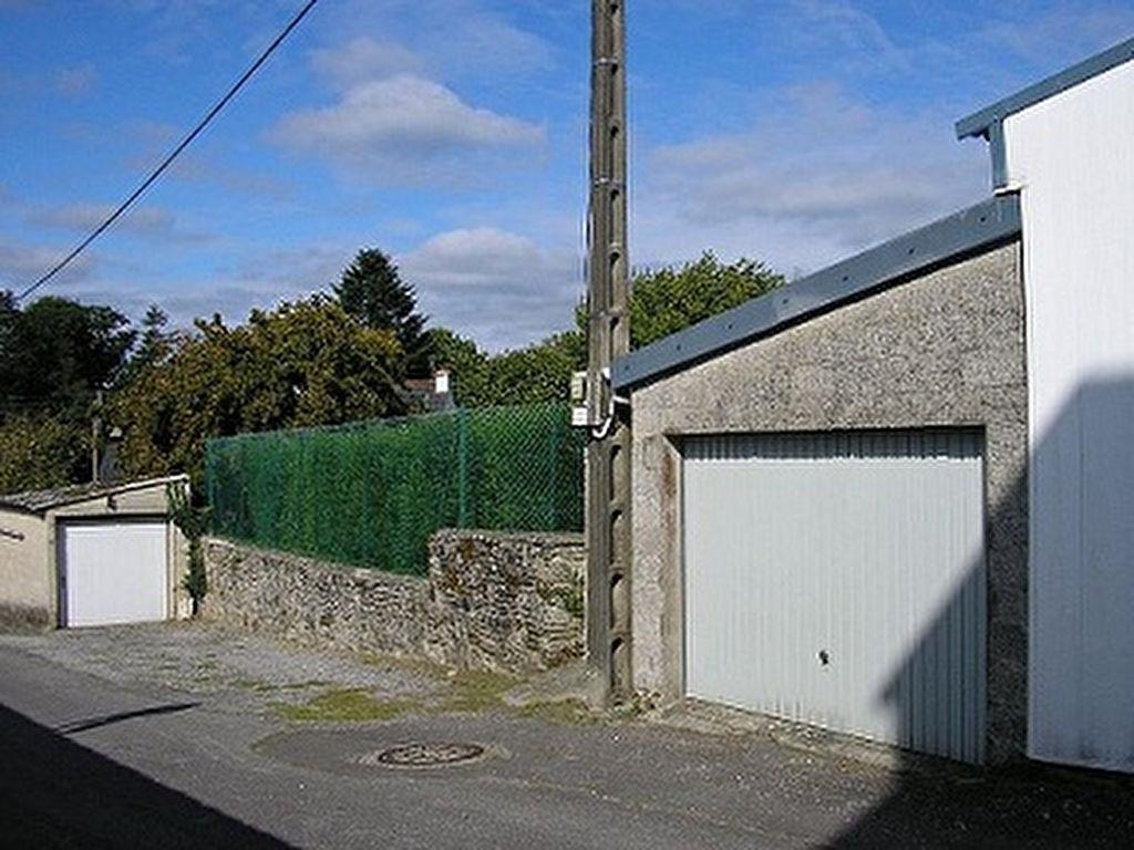 Garage sur terrain constructible de 295m² en centre ville