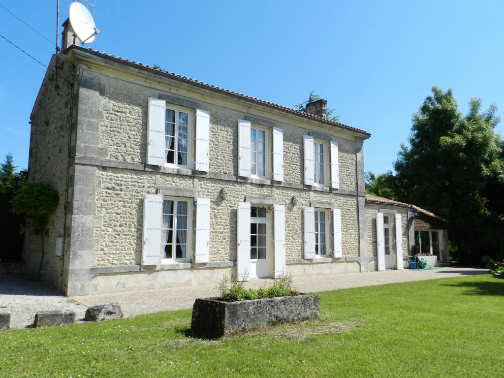 Charentaise with swimming pool in wooded parkland