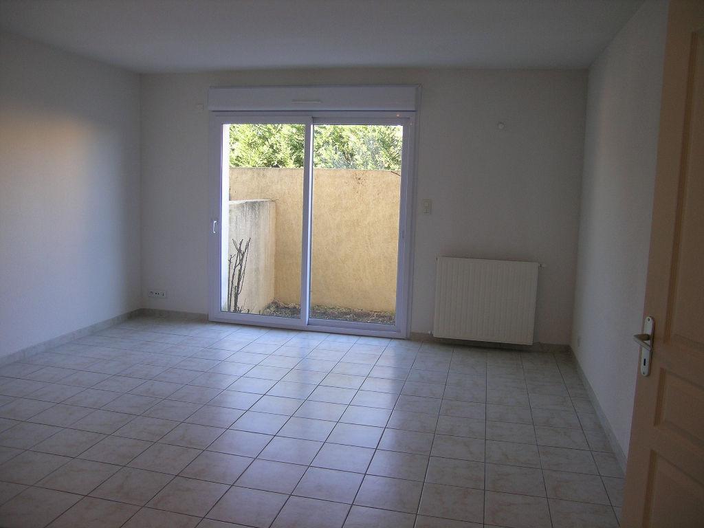 Appartement T3 avec garage et jardinet