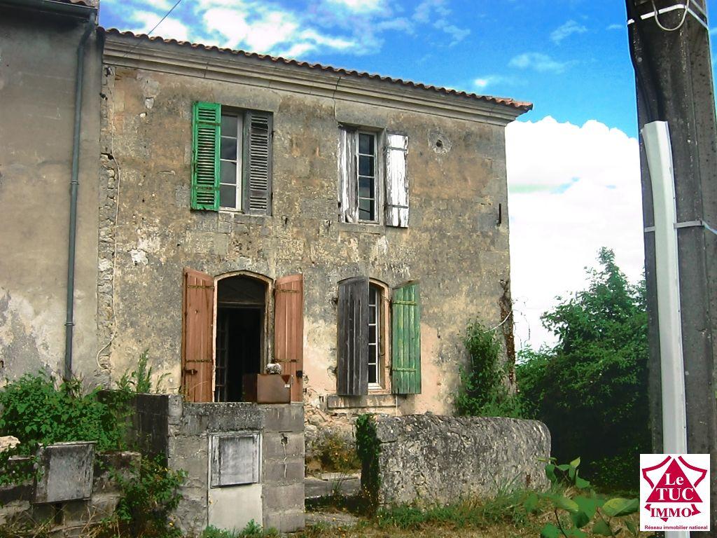 Maison en pierres sur terrain 1400 m² -  St André de Cubzac