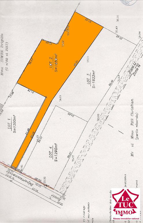 CAMPUGNAN Terrain à bâtir d'environ 1 450 m²